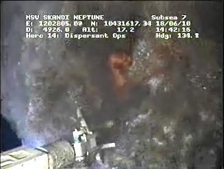 Oil spilling under containment cap